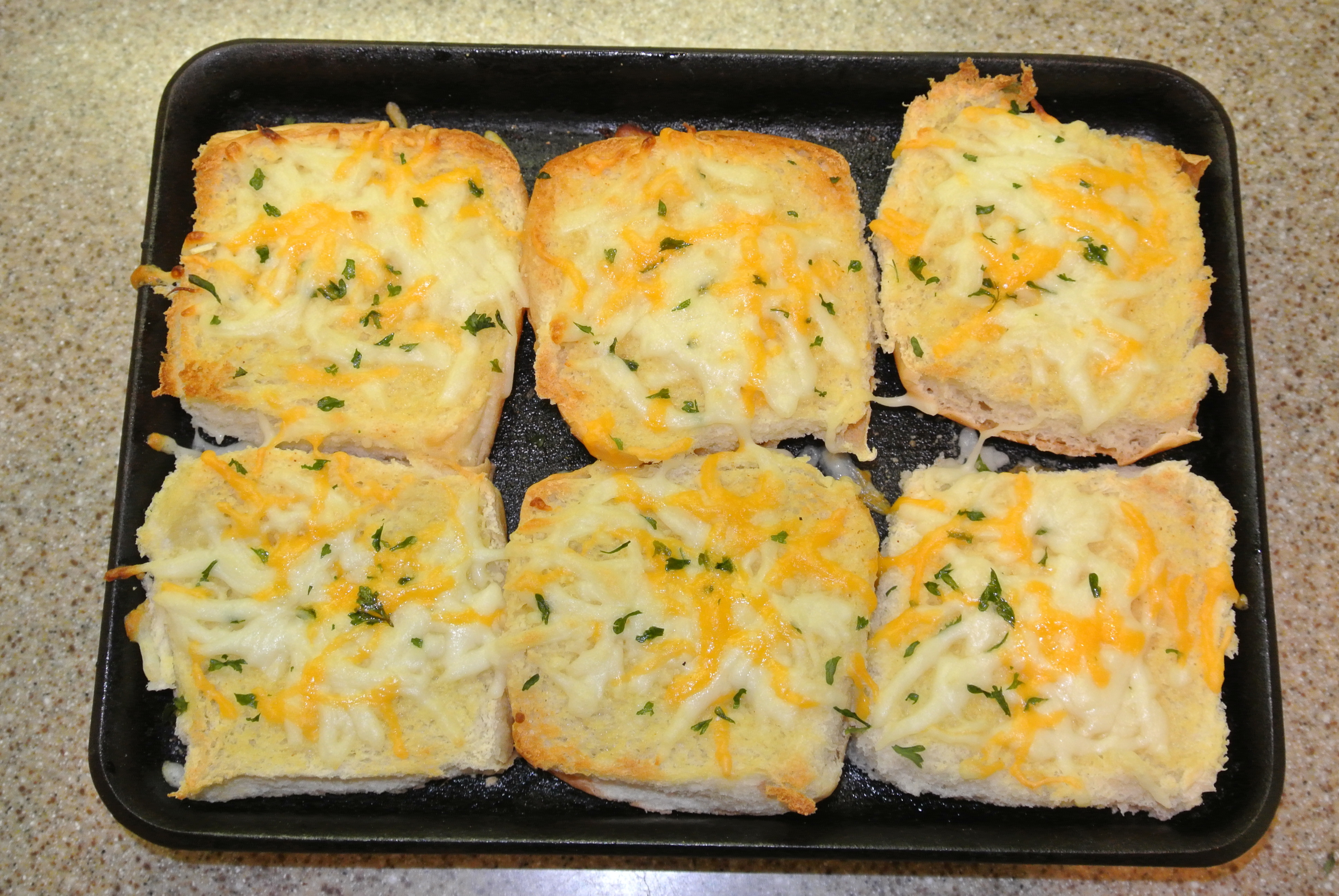 Quick and easy garlic bread made from leftover buns.