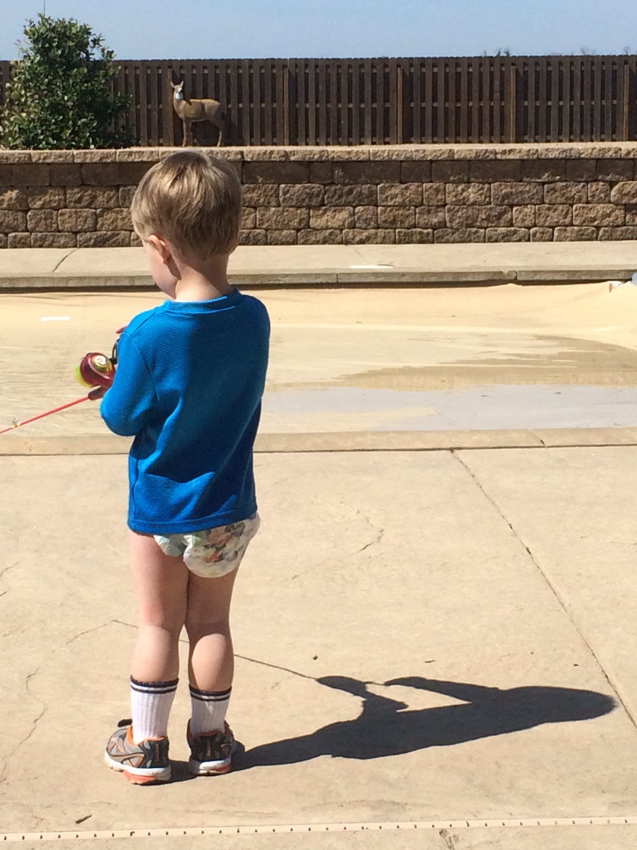 Mason fishing in the cement pond