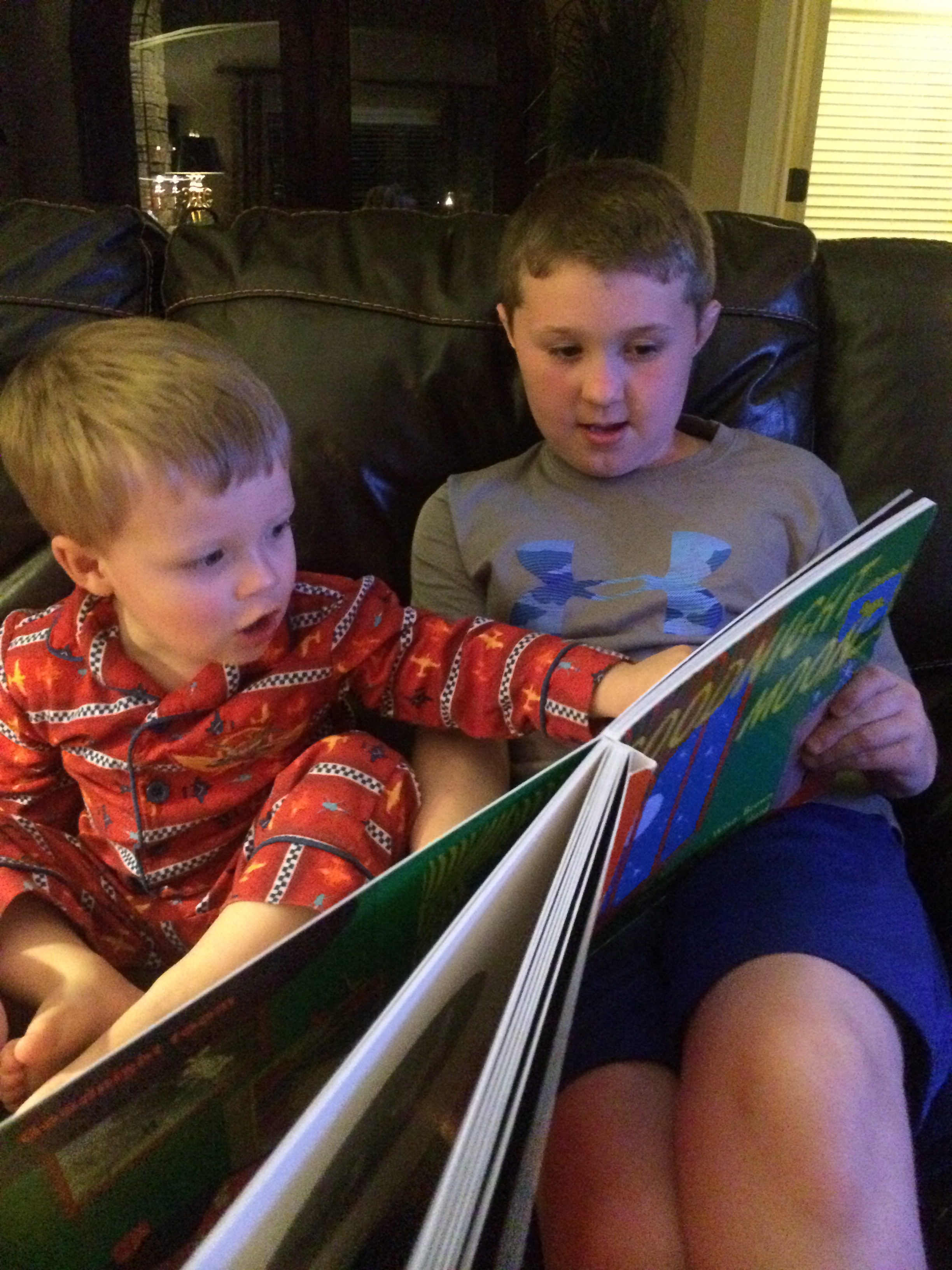 Older kid reading Goodnight Moon to a younger kid...never stop teaching and never stop learning