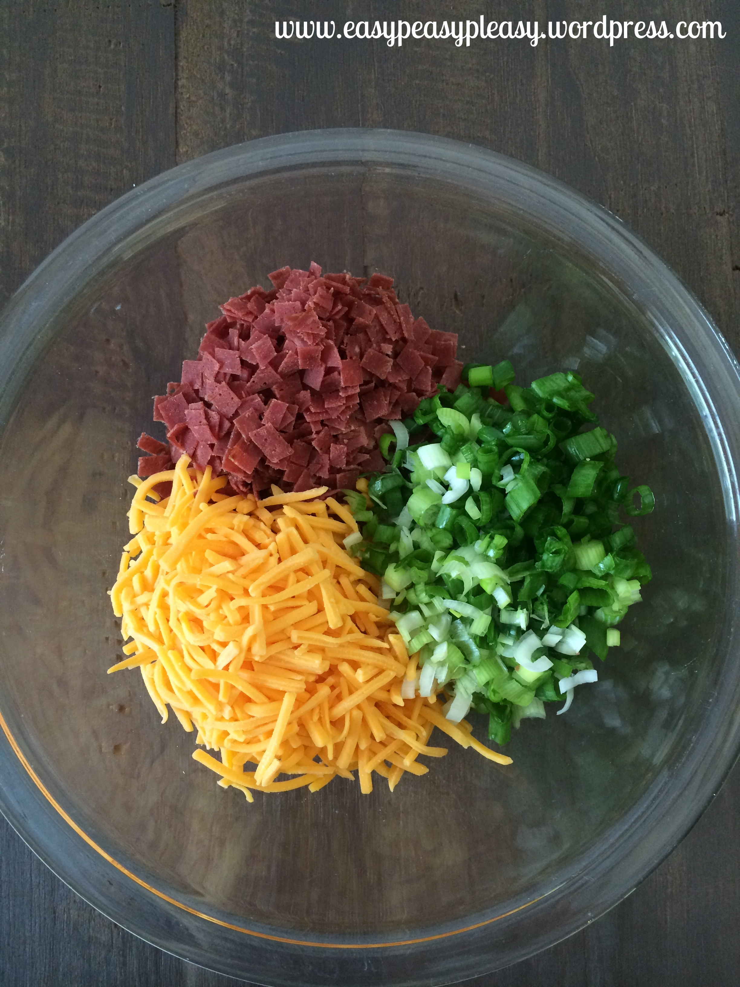 Green Onions, Dried Beef, Shredded Cheddar, and cream cheese is all you need to make the best cheese ball ever