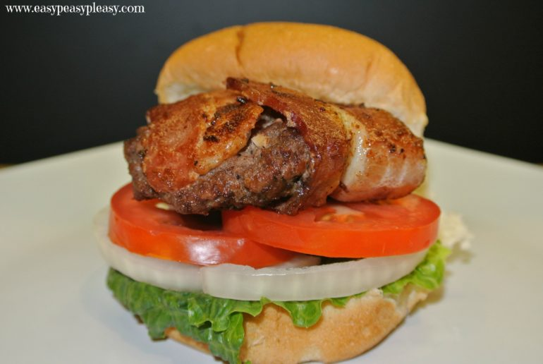 It's cookout season so spare the oven and fire up the grill with these bacon wrapped sliders. There's no need to cook the bacon ahead of time. The bacon cooks on the burger!