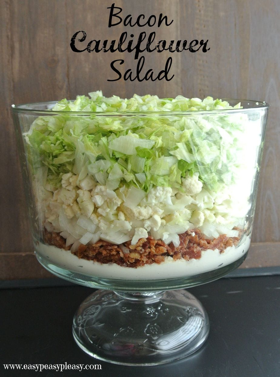 Bacon Cauliflower Salad is a huge hit and feeds a crowd! Assemble in layers ahead of time and mix all together right before serving.