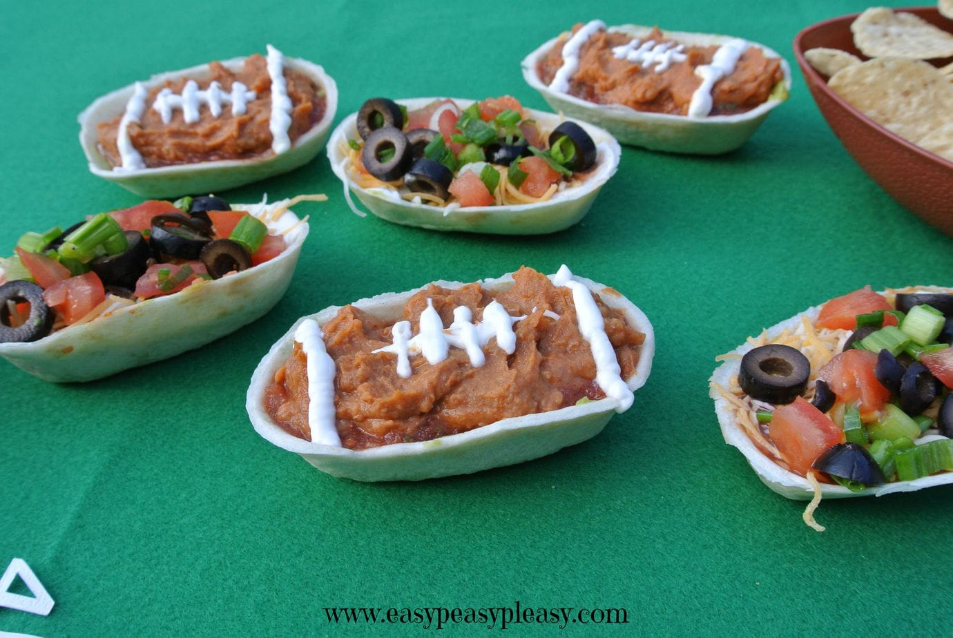 Come check out how to make these easy and delicious seven layer dip football bowls!