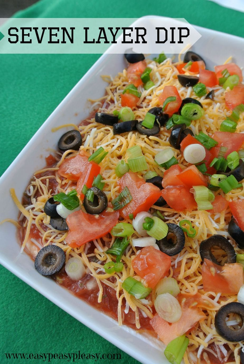 Easy and delicious game day Seven Layer Dip is my go to appetizer!