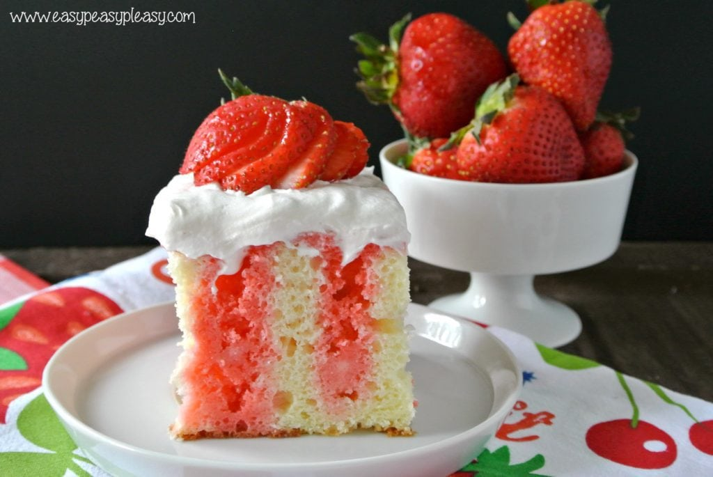 Make this decadent Strawberry Poke Cake Skinny with my lightened up version!
