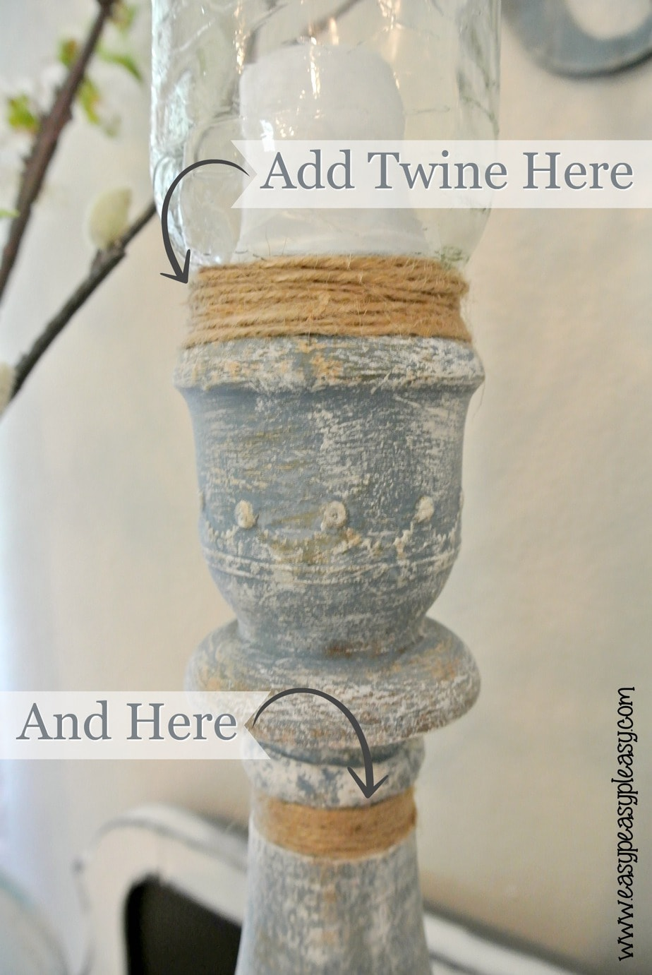 Transforming wax covered yard sale candle holders using twine.