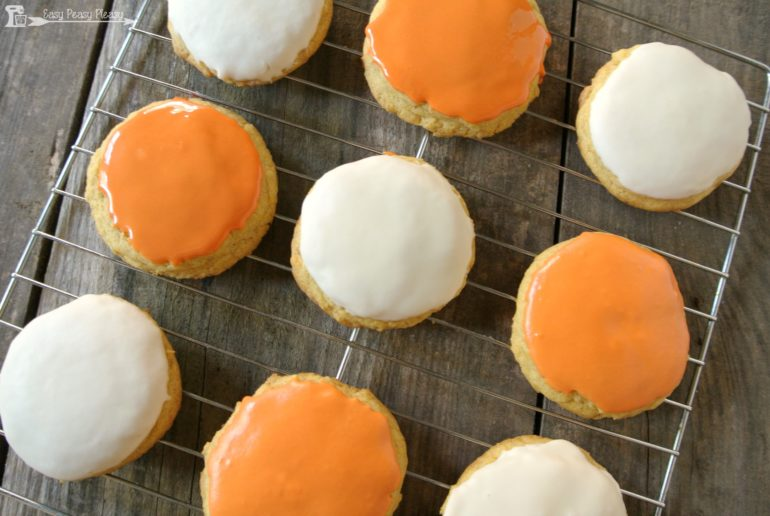 Make these easy glazed pumpkin cookies using only 4 ingredients total. If you have a box of cake mix and some store bought frosting this recipe is for you!