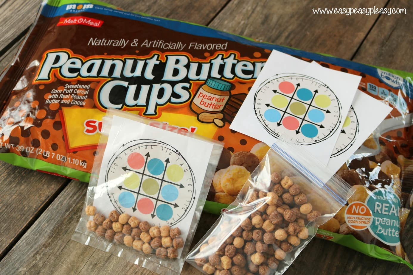 (AD) Peanut Butter Cups Cereal from Malt O Meal make the perfect X's and O's for this free printable tic tac toe lunchbox game.