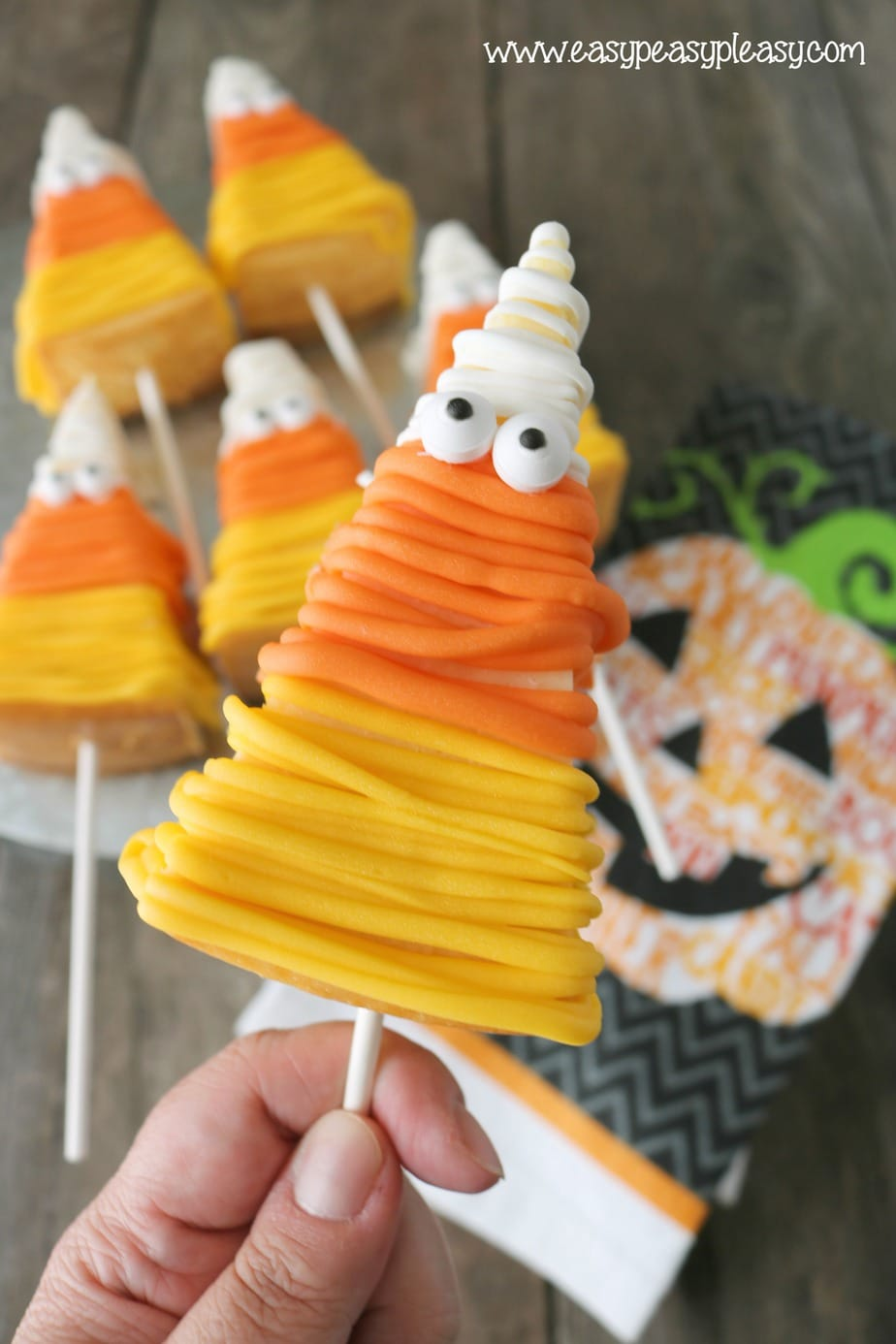 Get your Halloween Mummy on with these Candy Corn Cheesecake on a Stick. No Bake recipe at easypeasypleasy.com