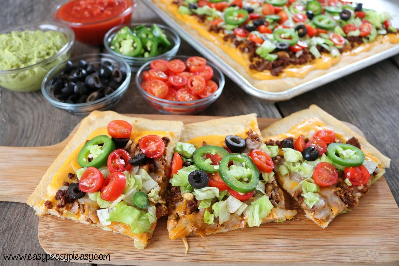 Grab a slice of the ultimate Sheet Pan Taco pizza.