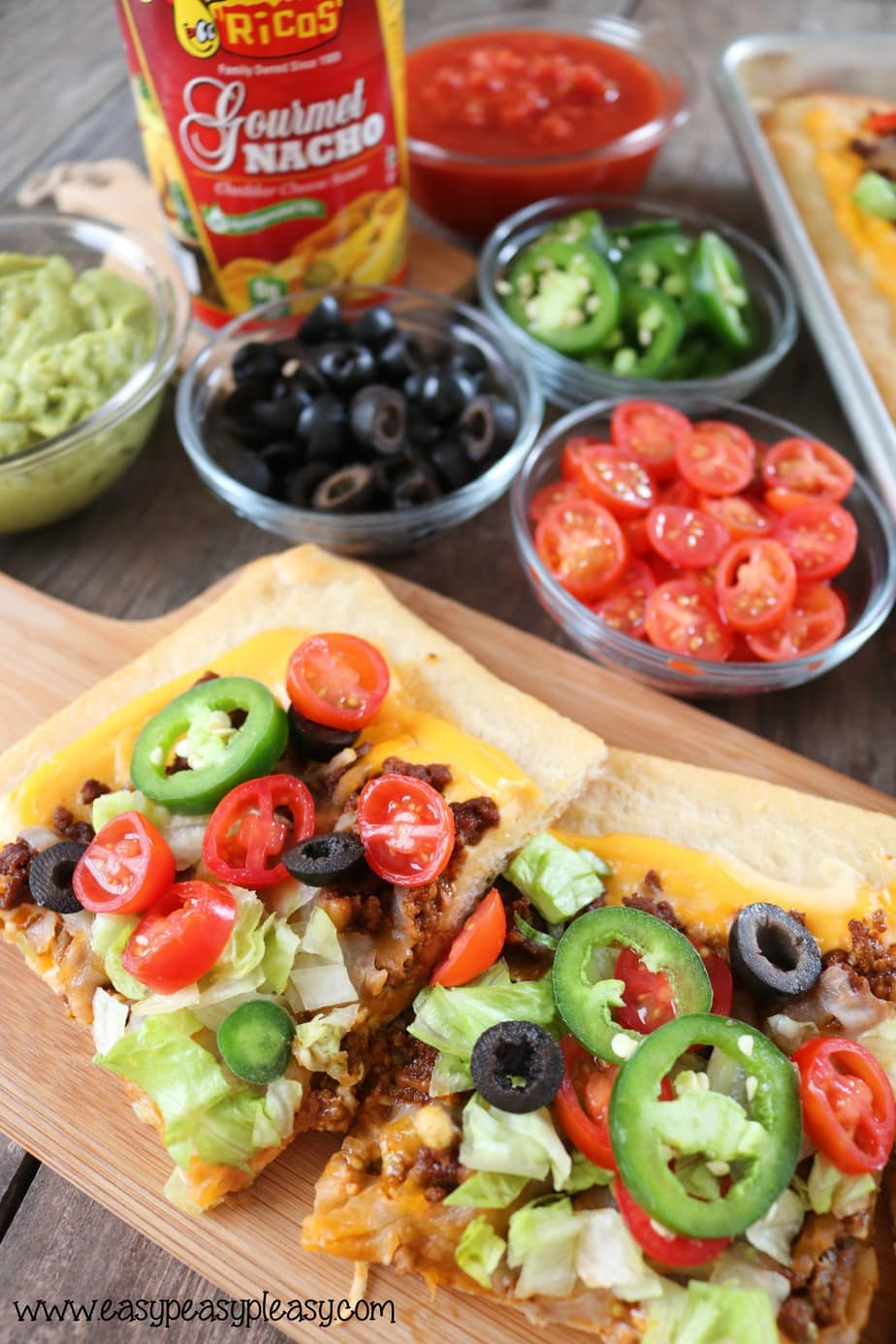 Make the ultimate sheet pan taco pizza with Ricos Gourmet Nacho Cheese as your sauce.