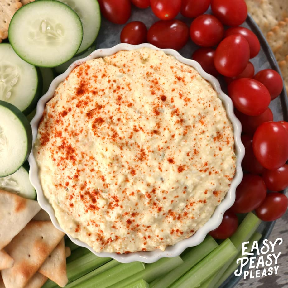 The perfect dip for holidays or any occasion. Classic Deviled Egg Dip will be a hit. #deviledegg #deviledeggs #deviledeggdip