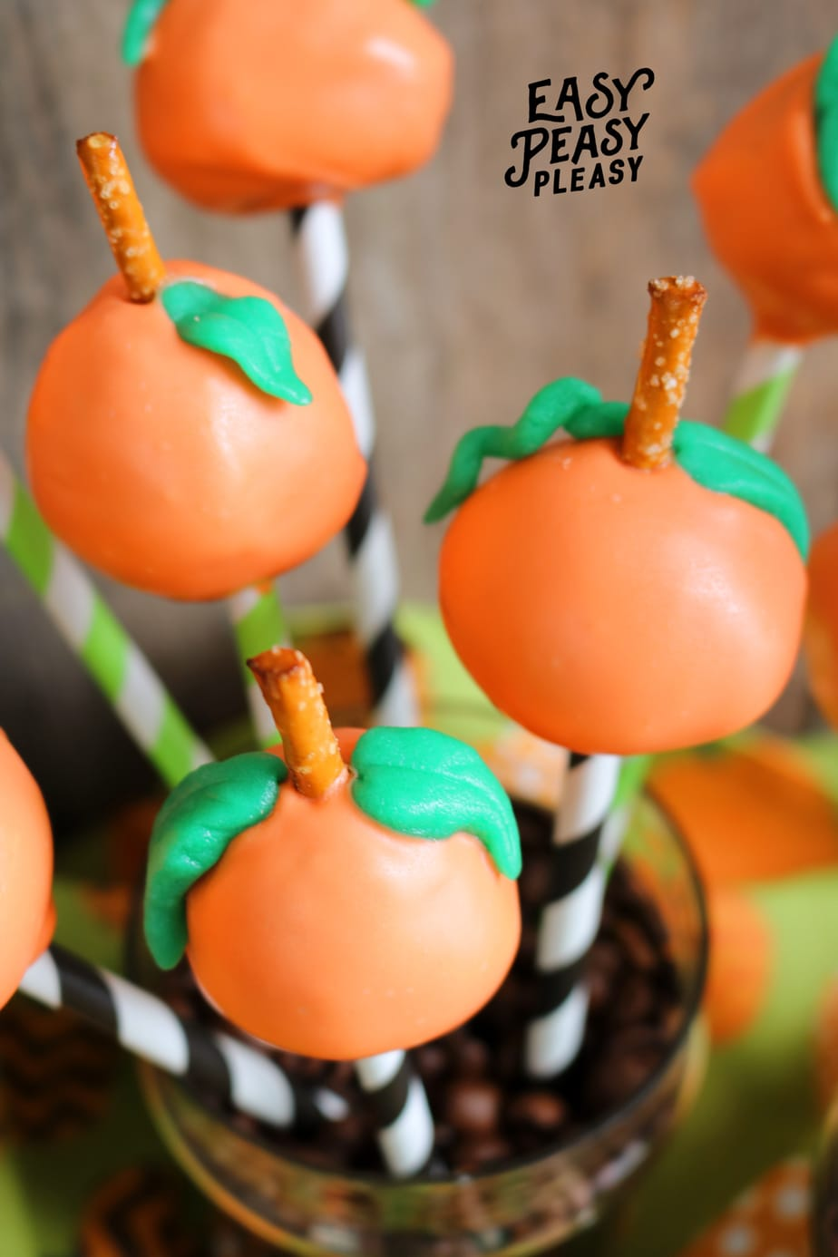 Grab these easy 5 Ingredients to whip up cute Donut Hole Pumpkin Pops perfect for fall and Halloween.